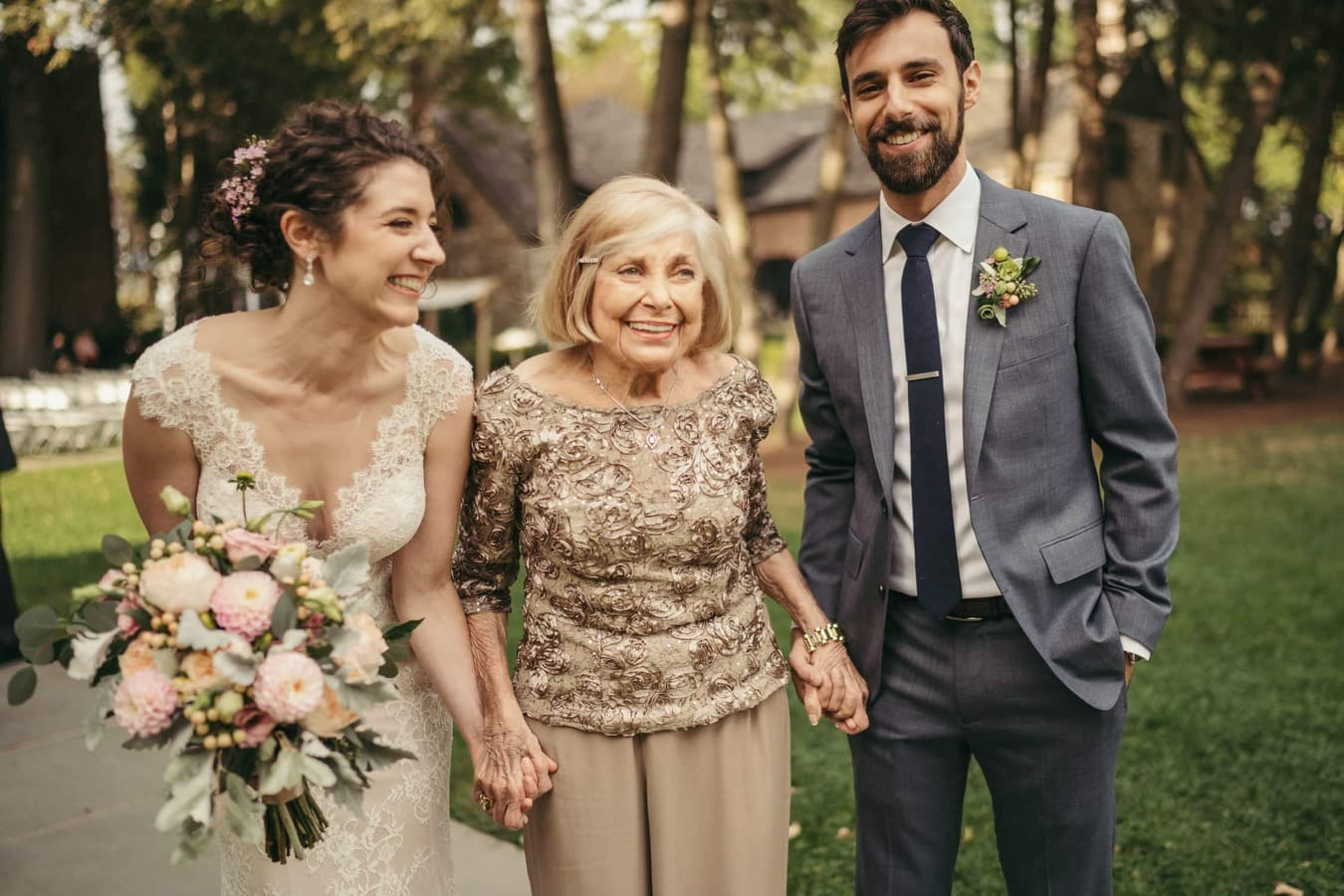Bride and groom smile and hold hands with grandma before wedding ceremony in Hudson Valley.