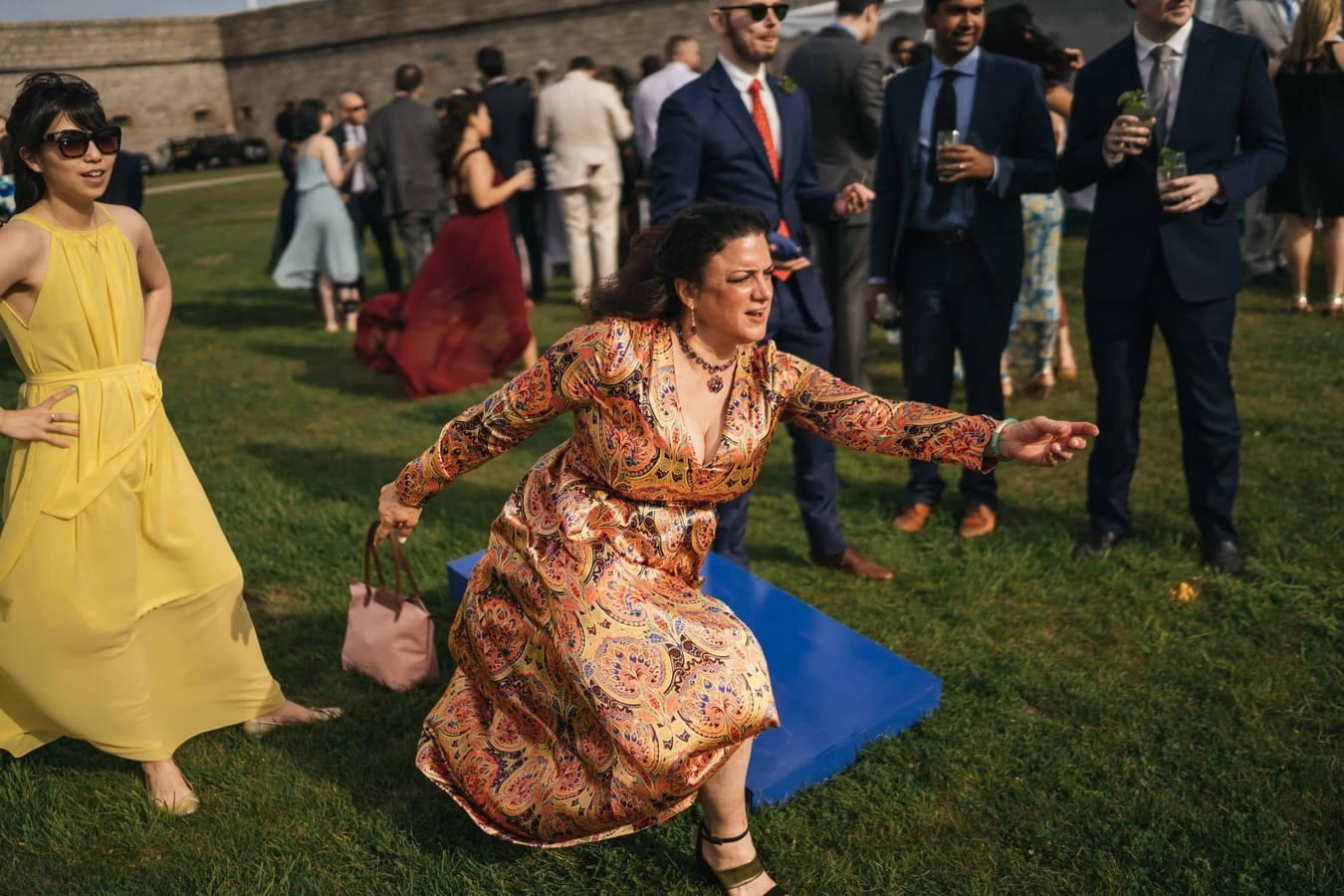 Woman plays hacky-sack during wedding reception in Rhode Island.