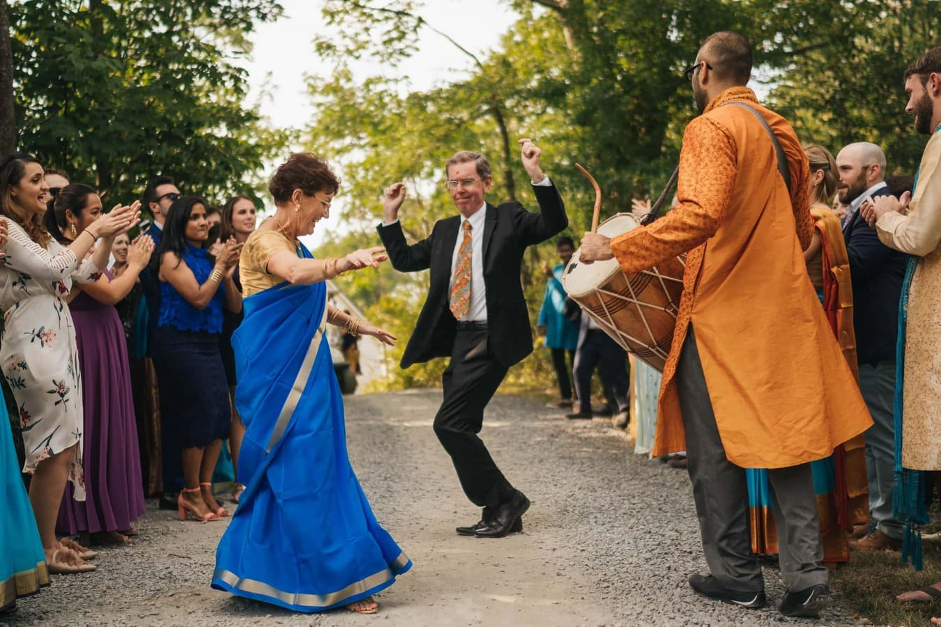 Groom's parents dance to Indian drum player before wedding ceremony at Cedar Lakes Estate in the Catskills.