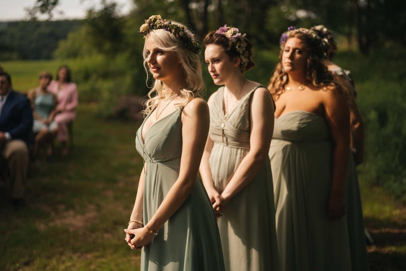 Afternoon light shines on bridesmaids during wedding ceremony in the Catskills.