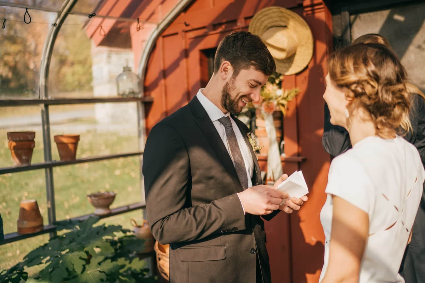 Groom reads wedding vows to bride during ceremony in Catskills.