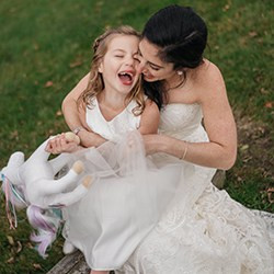 Bride tickles flower girl before Hudson Valley wedding ceremony.